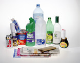 Assorted recyclables - plastic bottles, metal cans, cardboard and glass