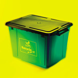 Recycling bin with lid on yellow background
