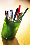 Using a glass as a pen and pencil holder in office