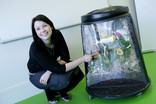Woman with glass-fronted compost bin