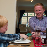 Father and son at Christmas - dinner table setting