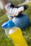 Two plastic drinks bottles with football