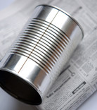 Food tin and newspaper