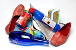 Shoes and clothing, blue glass bottle, plastic bottle and tub, soup tin