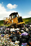 Compaction vehicle at landfill site