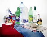 Assorted recyclables - metal cans, plastic bottles, glass, paper and card, clothing