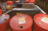 Waste oil and oil drums at a recycling point