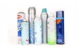 Row of assorted aerosol cans - with and without lids
