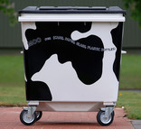 Recycling wheelie bin with cow design