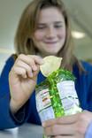 School pupils sharing packet of crisps