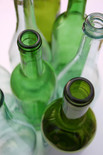 Assorted green and clear glass bottles