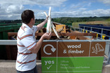 Man recycling wood at wood and timber recycling point
