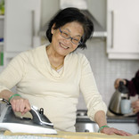 Couple in kitchen - making tea and ironing
