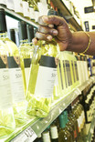 Removing a bottle of white wine from supermarket shelf