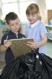 School pupils weighing rubbish bag for a school waste audit