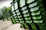 Stacked green wheelie bins