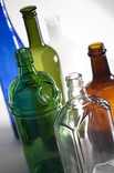 Clear, green, brown and blue bottles