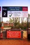 Green Garden Waste Only bay at recycling centre with signage