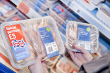 Comparing two packs of chicken in supermarket - one small, one special purchase size