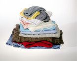 Pile of textiles - men's clothes, socks, underwear, tea towels, cloths