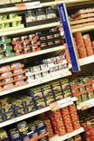 Shelves of tinned fish in supermarket