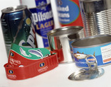 Assorted drinks cans and food tins - close up