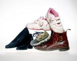 Pile of shoes - women's, children's, men's