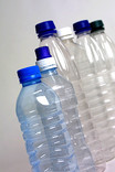 Line of clear plastic water bottles with lids