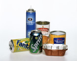 Assorted metal packaging lined up - aerosol, drinks cans, food tins, foil tray