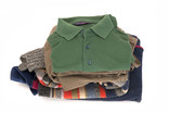 Pile of men's tops and jumpers