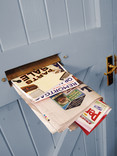 Mail in letterbox of blue door