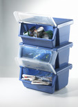Stack of recycling bins with compartments and lids
