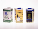 3 different branded milk cartons in a row