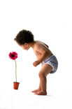 Baby wearing re-usable nappy with flowerpot