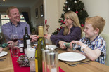 Family at Christmas - dinner table setting