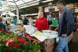Man buying recycled soil improver at garden centre