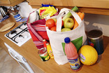 Bags of food shopping on kitchen counter