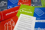 Assorted school recycling communications materials - bin labels, recycling policy, posters