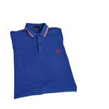 Folded blue polo shirt