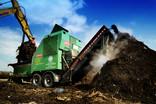 Industrial composting process - vehicles unloading garden waste