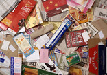 Assorted paper and card with boxes, mail, newspapers and leaflets