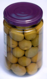 Glass jar of green olives