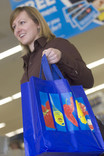 Woman with re-usable shopping bag