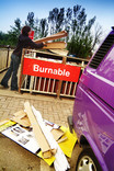 Woman with cardboard at burnable recycling point at recycling centre