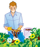 Man using compost in flower border