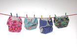 Re-usable nappies hanging on a washing line